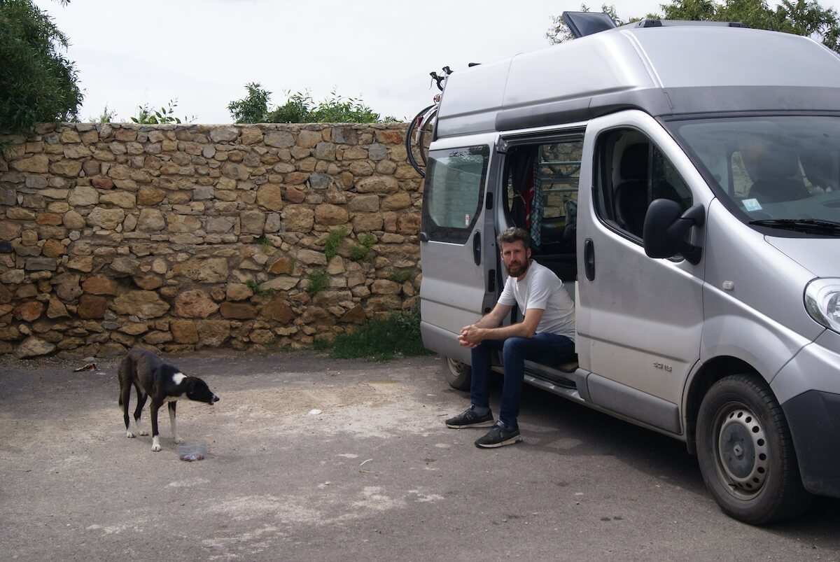 Traveling to Morocco by Campervan - Feeding stray dogs